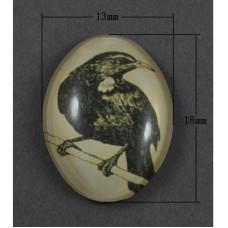 Кабошон Птица темно-оливкового цвета, овальная, размер 13х18 мм.